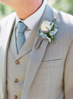 We love this shade of gray with a soft blue accent in the boutonniere for a #summer wedding | See more on Style Me Pretty: http://www.StyleMePretty.com/northwest-weddings/2014/01/16/jackson-hole-wedding-at-hotel-terra/  Carrie Patterson Photography