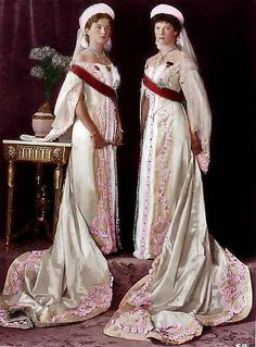 Russian Court dress.Grand Duchess Olga Nikolaievna (left) and Grand Duchess Tatiana Nikolaievna in their Ceremonial dresses to Imperial Court, circa 1913.