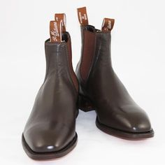 """R.M.'s""(RM Williams riding boots) iconic Aussie brand - made from a single piece of leather, originally designed to be worn by outback stockmen without socks, but seen as often at church or in the boardroom. My last pair died an early death at 14 yo."