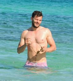 Shirtless hunk Jamie Dornan shows off his rippling muscles as he enjoys beach holiday in Ibiza with his wife Amelia Warner and daughter Dulcie
