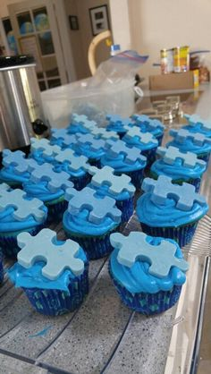 Blue Velvet cupcakes with Blue Chocolate Puzzle Pieces  I baked regular blue velvet cupcakes and iced with blue butter cream frosting. Then I made chocolate puzzle pieces by dying white meltable chocolate blue then putting in a silicone puzzle mold. Voila!