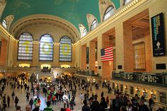 """Grand Central Terminal Main Concourse, New York City, in its centenary year 2013. You can just see parts of some of the constellations on the ceiling. The concourse measures 275ft (84m) long, 120ft (37m) wide and 125ft (38m) high. (Photo Credit: Ingfbruno) Mona Evans, """"Sky of Grand Central Terminal - History"""" http://www.bellaonline.com/articles/art301156.asp"""