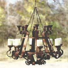 Two feet of rusty metal curlicues and flourishes. Two levels and sizes of candle cups to adjust the drama. Hangs from a chain to render it mobile. Would be breathtaking for a special dinner on the law.