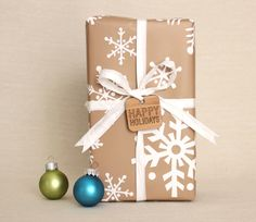 kraft gift wrap with white snowflakes and wood tag