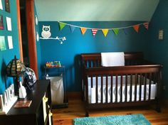 I love how bright the room is, but it's still meant for a baby boy.