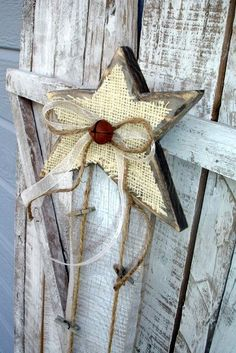 Rustic Burlap Christmas Card Holder//  Wooden star covered with burlap and a jingle bell accented with hay string.  Looks easy enough and I LOVE the hay string idea for a rustic