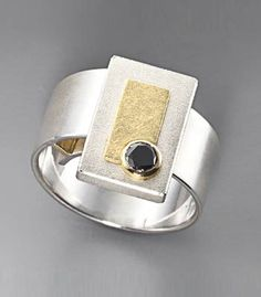 Janis Kerman Ring with Black Diamond Ring in sterling silver, 18k gold, and set with a black diamond.
