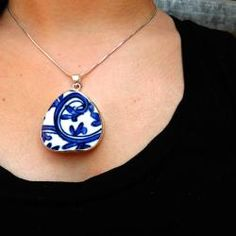 @Overstock - Enhance your outfit with a necklace skillfully hand-crafted by women freed from exploitation. Made from shards of traditional, hand-painted Chinese pottery this blue and white ceramic pendant is suspended from a sterling silver chain.http://www.overstock.com/Worldstock-Fair-Trade/Chinese-Procelain-Oval-Pendant-Necklace-China/6705476/product.html?CID=214117 $19.99