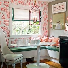 This space is so feminine and I adore it! I also love the banquet seeting. I've always wanted one in my house. It's a great use of wallpaper too!