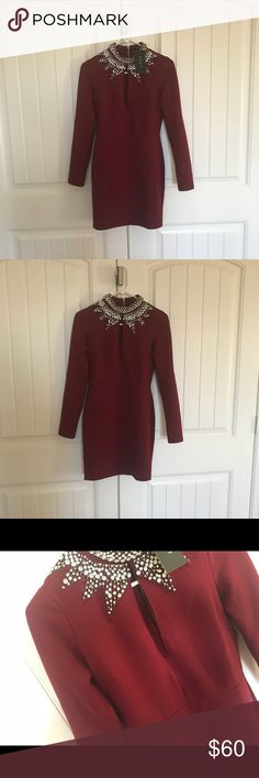 BRAND NEW BURGUNDY DRESS WITH SILVER STONES Brand new with tags   Really good quality  Really stretchy and thick material  * really thick good quality spandex type   Beautiful burgundy tone with silver stones   Price is firm  Comes sealed in package  The one in the picture is a medium   1small 1medium 1large Dresses Long Sleeve