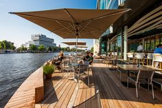 Cafe-Restaurant RIVA, Amstelboulevard, Amsterdam. Terrace next to the Amstel, Lovely Drinks, and Food by an Australian chef.