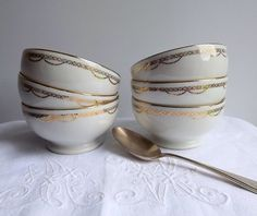 Six porcelain Limoges bowls, in white and gold. These bowls would be useful for so many things. They are in white bone china (porcelain) with a