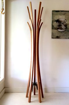 The Musk Coat Stand. Commissioned design and fabrication by usethings. Coat stand from steam-bent and laminated hardwood with solid stainless steel bracket / counterweight.