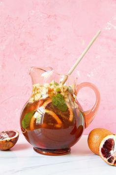 Kombucha Sangria – A Beautiful Mess - love the infusion of fresh ingredients, wine, brandy & kombucha!