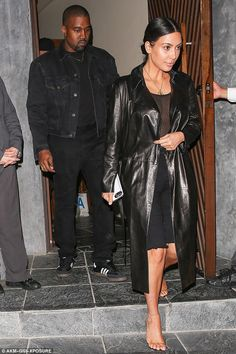 Suddenly shy? Braless Kim Kardashian covers her sheer top with jacket #dailymail