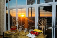 Enhance your wedding reception with a gorgeous chocolate fountain from Yummie Fountains to delight your guests. With the sunset backdrop in our Wavecrest Ballroom you will love this display! Photo: Julio Fonyat #yummiefountains #chocolatefountain #hgicarlsbad #carlsbadwedding #sandiegowedding #beachwedding #sunsetwedding #sunset #weddingreception