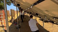 All hands on deck under the Solar panels - Vacaville California HVAC Solano Napa Fairfield Benicia Vallejo Suisun Green Energy Solar Panel Installation, Solar Panels, Vacaville California, Heating And Air Conditioning, Deck, Weather, Hands, Green, Sun Panels