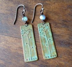 Etched Copper Earrings with Flower and Labradorite by annemoorejewelry, via Flickr