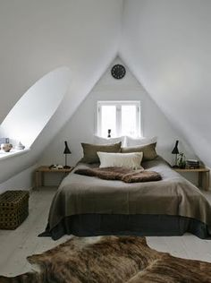Bedroom of a modernised cottage, probably in Denmark, photographed by Stuart McIntyre. #stuart_mcintyre #photography #architecture #danish #cottage #interiors #design #bedrooms #white #brown #light #modern