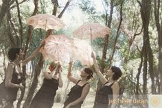four-bridesmaids-dressed-in-matching-black-dresses-holding-matching-peach-coloured-lace-umbrellas