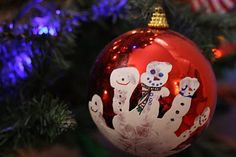 I think we'll be making these this year! Christmas ornament with handprint using white paint, turning the fingers into snowmen