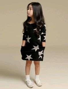 This Black Star Dress has long sleeves and Allover Star Print.