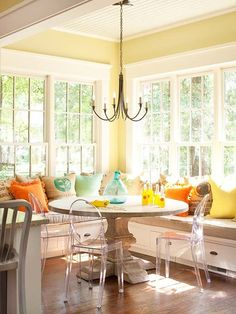 bhg banquette with yellow walls ~ Love the cheery colors and pedestal table.