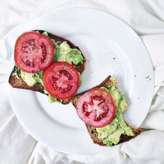 smashed avo with lime, chili flakes + salt and tomato on gluten free bakery bread