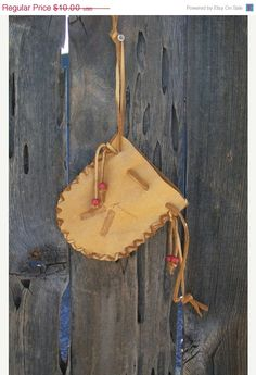 Buckskin drawstring pouch with burned feathers  leather medicine bag