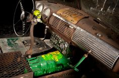 ratrod interior with exposed and painted transmission, wrench shifter, license plate gauge and air ride switch panel all in a Chevy Chevrolet Advanced Design pickup truck cab.