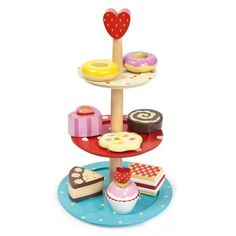 The Le Toy Van Cake Stand Set is part of the wonderful Honeybake collection. It comprises a wooden cake stand and 8 beautifully decorated and delicious looking cakes. Wooden Cake Stands, 3 Tier Cake Stand, Wood Cake, Wooden Play Food, Wooden Toys, Patisserie Cake, Three Tier Cake, Afternoon Tea Parties, Imaginative Play