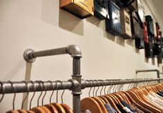 Cala fashion boutique, Grand Canyon Haifa, Israel 2013 - detail  featuring custom-made clothes hanger made of galvanized iron pipes  #boutique #interior #design #interiordesign #custom_made #clothes_hanger #galvanized #iron #pipes interior design by itzik albo איציק אלבו עיצוב פנים