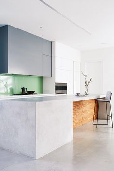 How to introduce colour into your home. kitchen-green-splash-back-blue-cabinetry-apr16