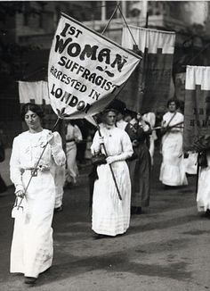 "1913 - Note banner: ""First Woman Suffragist[s?] Arrested in London. I wonder if that identifies someone in the procession, or calls out the event?"