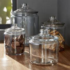 Shop Heritage Hill Glass Jars with Lids. A refresher course in retro storage and service. These classic lidded glass jars have been in production since the the perfect see-through container for snacks or for ladling up beverages like lemonade or sangria. Glass Food Storage, Food Storage Containers, Glass Containers, Glass Cookie Jars, Glass Jars With Lids, Glass Candy Jars, Kitchen Jars, Glass Kitchen, Kitchen Dining