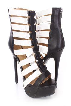 Doll up any outfit with these stylish heels! They will look super hot paired with your favorite skinnies or dress. Make sure you add these to your closet, it definitely is a must have! The features include a faux leather upper in a strappy two tone design, open toe, stitched detailing, high polished hardware accents, back zipper closure, smooth lining, and cushioned footbed. Approximately 5 1/2 inch heels and 1 3/4 inch platforms.http://www.amiclubwear.com/shoes-heels.html