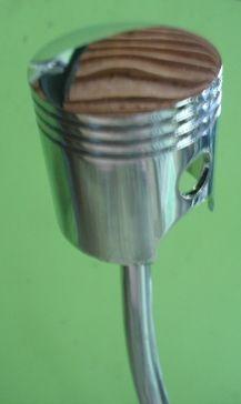 motorcycle piston shifter knob, found here:  http://prostores3.carrierzone.com/servlet/hotrodshiftknob_com/-strse-Other-fdsh-Misc-cln-CHROME-PISTON-SHIFT-KNOBS/Categories