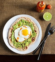 Ideas to make great tasting breakfast creations - Avocado and Egg Breakfast Pizza. Substitute Cholula with a few drops of Molli Mexico City Cooking Sauce and enjoy.