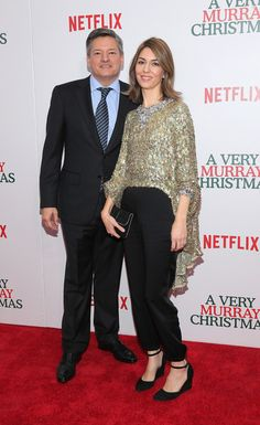 """(L-R) Vice President Netflix Content Acquisitions, Pauline Fischer, Ted Sarandos, Jason Schwartzman, Jenny Lewis, Mitch Glazer, Paul Shaffer, Bill Murray, Sofia Coppola, Thomas Mars and Roman Coppol aattend """"A Very Murray Christmas"""" New York premiere at Paris Theater on December 2, 2015 in New York City."""