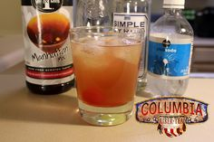 Columbia Liber-tea (Bioshock Infinite mocktail)  Ingredients: 2 oz Manhattan Mix (Mr. & Mrs. T Manhattan Mix used) .5 oz Lemon Juice .5 oz Simple syrup Club Soda 1 Maraschino cherry