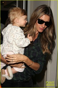 Gisele Bundchen walks through LAX Airport with her daughter Vivian on February 9, 2014