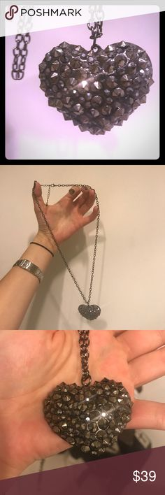 Spike bling long necklace!! Ugg I love this but never wear it and I'm spring cleaning:(.  Enjoy for me!;) lol.  Long sparkly heart spike necklace! UNIF Jewelry Necklaces