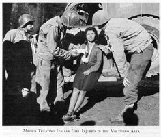 "American medics treating Italian girl near the Volturno River, 1943. In ""On Distant Shores,"" Tech. Sgt. ""Hutch"" Hutchinsons cares for Lucia, a little Italian orphan, at the 93rd Evacuation Hospital in the Volturno area."