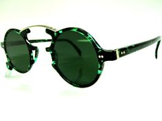 JEAN PAUL GAULTIER Sunglasses Mod. JUNIOR 58-0271 Col. GREEN $299.00 Steampunk Sunglasses, Cool Sunglasses, Round Sunglasses, Jean Paul Gaultier, Glasses Brands, Fashion Eye Glasses, Optical Glasses, Eyeglasses, Eyewear