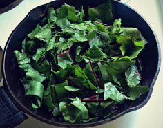 beet greens in pan