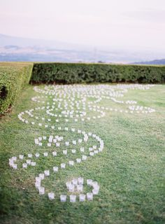 Swirling Votives On The Lawn Ceremony Decor