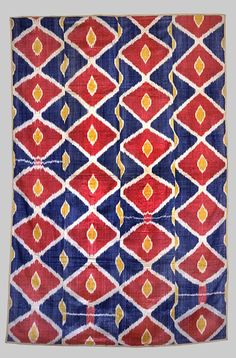 Wall- hanging, Uzbekistan Cotton warp, silk weft, ikat- dyed; woven. Measurements: 92 in x 64 in - 234 cm x 163 cm. Esther Fitzgerald Rare Textiles.