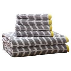 Add the Darcy 6 Piece Towel Set to your bathroom for a fun and bright update! These 2-ply ring spun towels are cotton jacquard woven making them reversible in contrasting colors as well as incredibly absorbent. Each towel features a bold teal geometric print with a small grey dobby border. Set includes two bath towels and four hand towels.