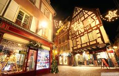 Typical timber-framing houses witn Christmas lights at the city center by night. Colmar. Wine route. Haut-Rhin. Alsace. France