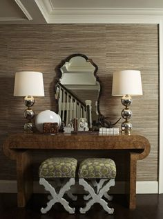 Love the wallcovering - grass cloth I think. Love the mirror and lamps.